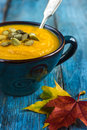 Pumpkin soup on a bowl Royalty Free Stock Photo