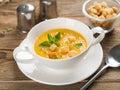 Pumpkin soup bowl of cream selective focus Royalty Free Stock Image