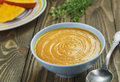 Pumpkin soup bowl of on a wooden table Stock Image