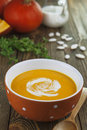 Pumpkin soup bowl of on a wooden table Stock Photo