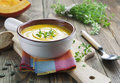 Pumpkin soup in the bowl on a wooden table Royalty Free Stock Photos