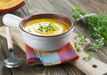 Pumpkin soup in the bowl on a wooden table Stock Image