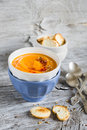 Pumpkin soup in ceramic bowls on a light wooden background Royalty Free Stock Photos