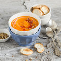 Pumpkin soup in ceramic bowls on a light wooden surface Stock Photos