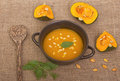 Pumpkin soup in clay pot Royalty Free Stock Photo