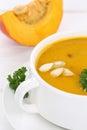 Pumpkin soup closeup with pumpkins in bowl