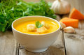Pumpkin soup with croutons on wooden table Stock Photography