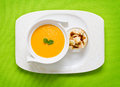 Pumpkin soup freshly made served on green with croutons Royalty Free Stock Photos