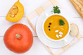 Pumpkin soup with pumpkins in bowl from above
