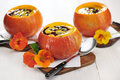 Pumpkin soup with seed oil and seeds selective focus Stock Image