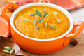 Pumpkin soup with seeds and honey in ceramic bowl close up Stock Photo