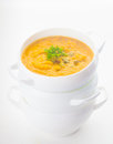 Pumpkin soup in white bowl on the white background Royalty Free Stock Photography