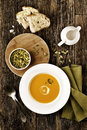 Pumpkin soup in a white bowl on a wood table Stock Photography