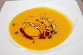 Pumpkin soup on white plate Royalty Free Stock Photo
