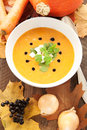 Pumpkin soup on wooden background Royalty Free Stock Images