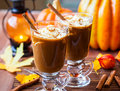 Pumpkin spice coffee with whipped cream and caramel Royalty Free Stock Images
