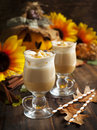 Pumpkin spice latte with whipped cream and caramel in glass cup Royalty Free Stock Photo