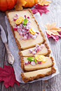 Pumpkin tart on gingerbread crust with candied cranberry Stock Images