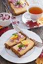 Pumpkin tart on gingerbread crust with candied cranberry Royalty Free Stock Image