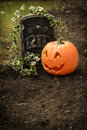 Pumpkin and tombstone dark grunge Royalty Free Stock Photo