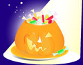 Pumpkin vase with candies and sparkles halloween full of sweets in the spotlight Stock Images