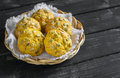 Pumpkin whole grain buns in a wicker bowl on dark wooden surface Royalty Free Stock Photos