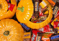 Pumpkins filled with halloween candy decorative assorted chocolate Stock Photo