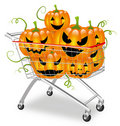 Pumpkins in a shopping cart Stock Images