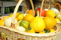 Pumpkins small in a basket for sale in romania Stock Photo