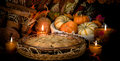 Pumpkins still life and cake on candle light Stock Photo