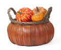 Pumpkins in straw basket mini an orange against a white background Royalty Free Stock Photo