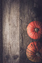 Pumpkins and turnip on the wooden table vertical Royalty Free Stock Photo