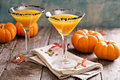 Pumpkintini pumpkin martini coctail with black salt rim for fall and halloween parties Stock Photos