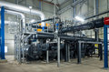 Pumps piping system inside industrial plant Royalty Free Stock Photography