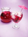 Punch cocktail drink with cherry fruit cruchon in glass ice and Royalty Free Stock Image