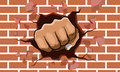 Punching fist smash through a concrete and brick wall Royalty Free Stock Photo