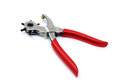 Punching plier with red handle on white Royalty Free Stock Photography