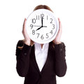 Punctual worker concept business woman wearing formal suit and holding big clock on face isolated on white background Stock Images