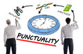 Punctuality concept with two businessmen Stock Photo