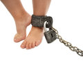 Punishment foot a little boy in chains Royalty Free Stock Photos