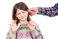 Punishment young girl being punished with ear pulling Stock Image