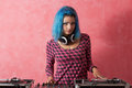 Punk girl DJ with dyed blue hair Royalty Free Stock Photo