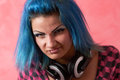 Punk girl DJ with dyed turqouise hair Stock Image