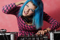 Punk girl DJ with dyed turqouise hair Royalty Free Stock Photos