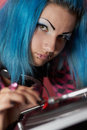 Punk girl DJ with dyed turqouise hair Royalty Free Stock Photography