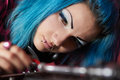 Punk girl DJ with dyed turqouise hair Royalty Free Stock Photo