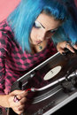 Punk girl DJ with dyed turqouise hair Stock Photography