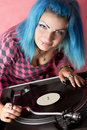 Punk girl DJ with dyed turqouise hair Royalty Free Stock Image
