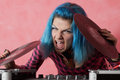 Punk girl DJ with dyed turqouise hair Royalty Free Stock Images