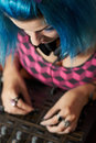 Punk girl DJ with dyed turqouise hair Stock Photos